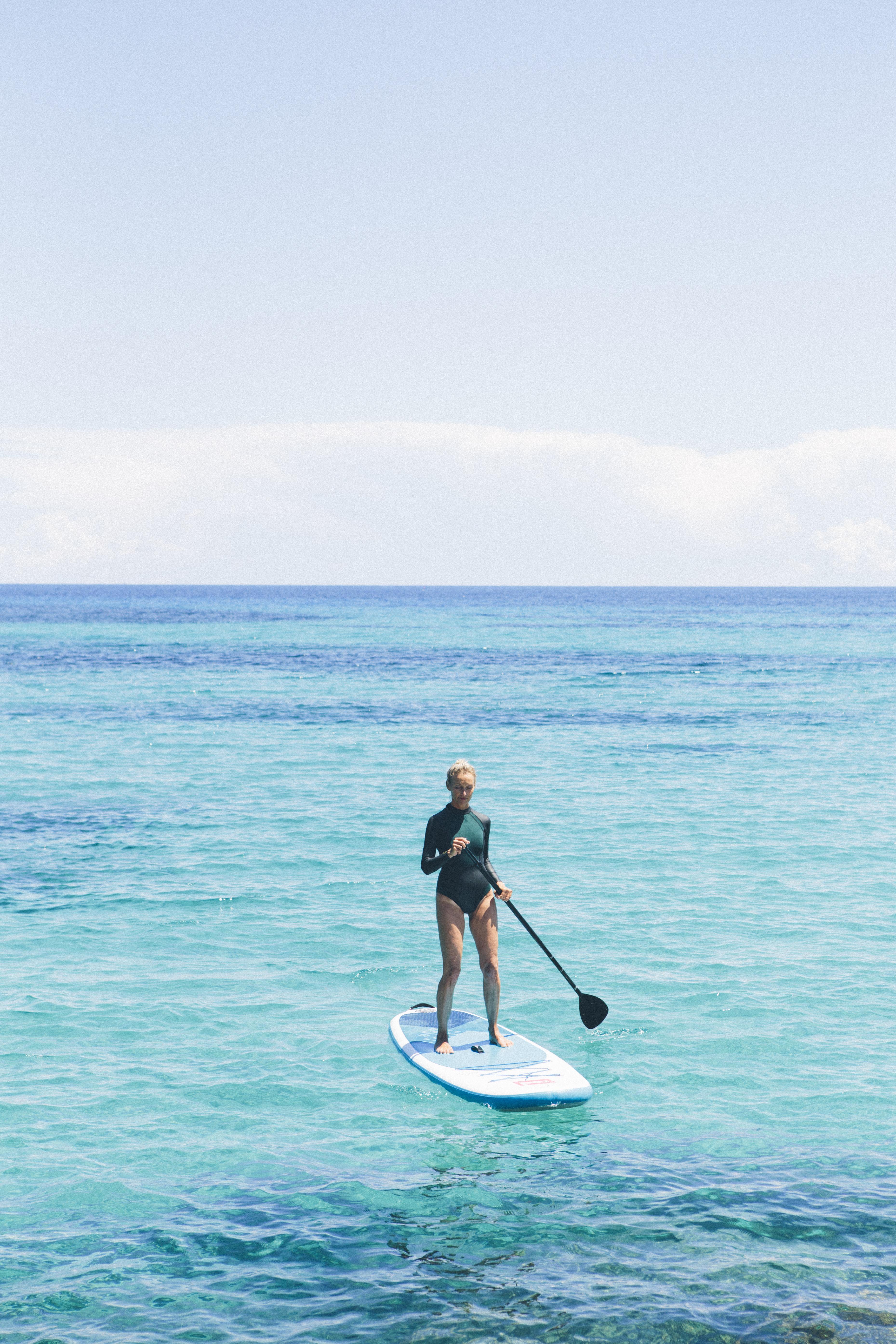 Paddleboard to practice balance